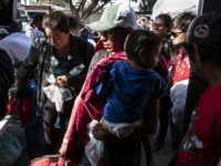 "Central American migrants travelling in the ""Migrant Via Crucis"" caravan arrive at ""Juventud 2000"" shelter in Tijuana, Baja California state,Mexico, on April 24, 2018. - The annual caravan, whose numbers have dwindled to about 600 people since it started on the border with Guatemala on March 25, is nearing the …"
