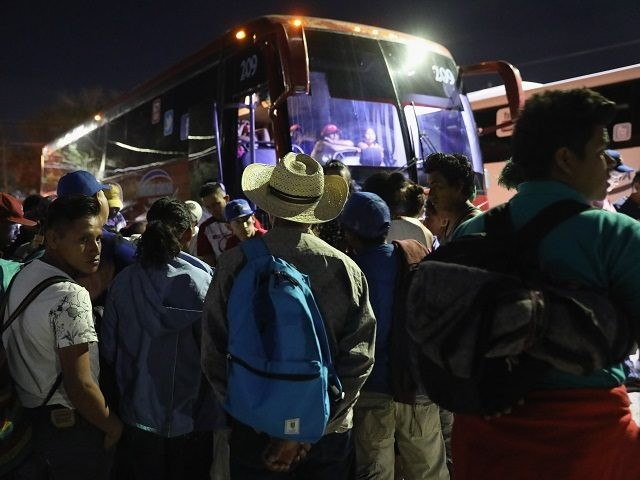 HERMOSILLO, MEXICO - APRIL 24: Central American asylum seekers wait for buses to take them to Tijuana on the U.S.-Mexico border on April 24, 2018 from Hermosillo, Mexico. More than 300 immigrants, the remnants of a caravan of Central Americans that began almost a month before set out on the …