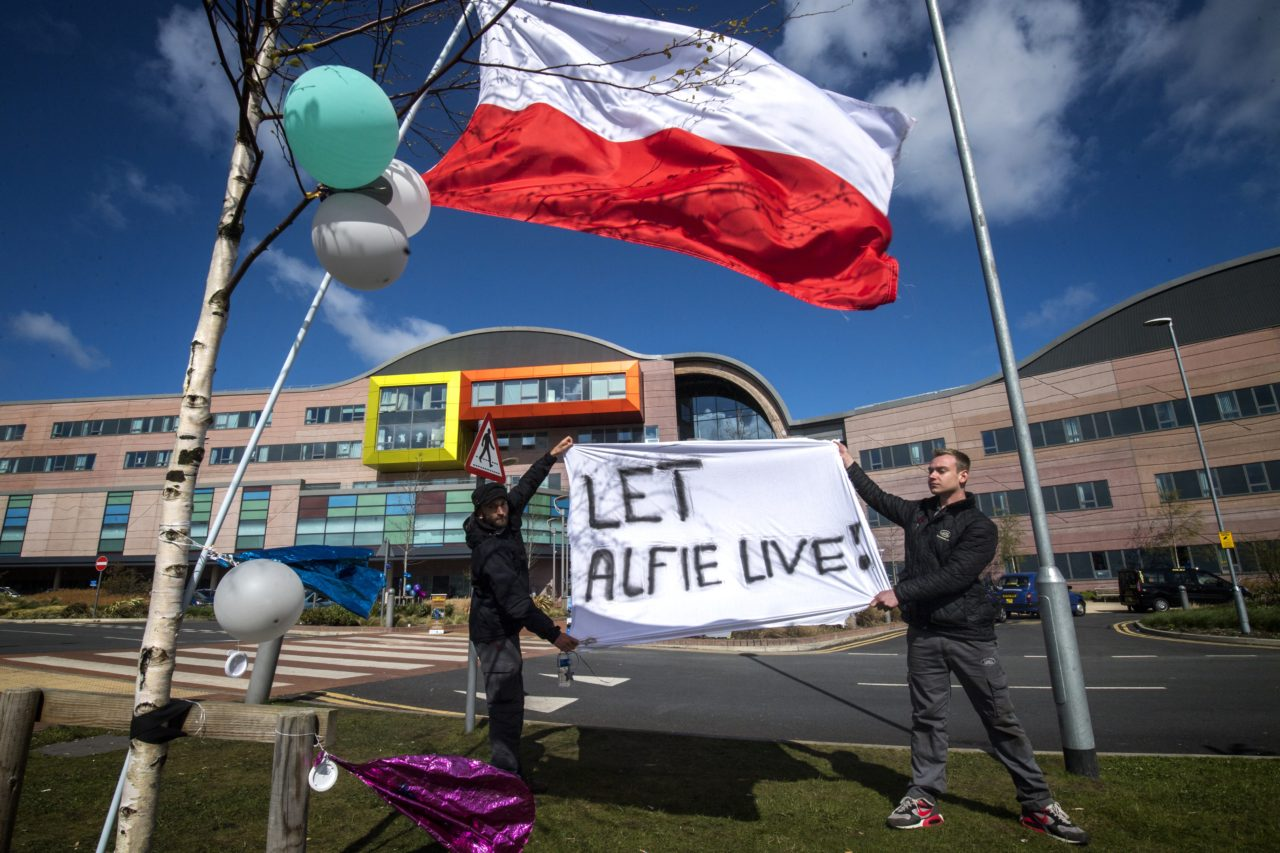 LIVERPOOL, ENGLAND - APRIL 26: Supporters of Alfie Evans hold a sign outside Alder Hey Children's Hospital on April 26, 2018 in Liverpool, England. Tom Evans the father of seriously ill, 23-month-old, Alfie Evans has said he will meet with doctors to discuss taking his son home. The Court of Appeal has upheld a ruling preventing Alfie's parents taking their son for treatment to Italy. (Photo by Anthony Devlin/Getty Images)