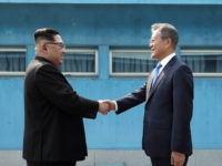 PANMUNJOM, SOUTH KOREA - APRIL 27: North Korean Leader Kim Jong Un (L) and South Korean President Moon Jae-in (R) shake hands over the military demarcation line upon meeting for the Inter-Korean Summit on April 27, 2018 in Panmunjom, South Korea. Kim and Moon meet at the border today for …