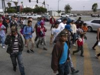 "Central American migrants travelling in the ""Migrant Via Crucis"" arrive at the Padre Chava's kitchen soup for breakfast and legal counseling, in Tijuana, Baja California State, Mexico, on April 27, 2018. - The US has threatened to arrest around 100 Central American migrants if they try to sneak in from …"