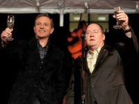 Bob Iger, Chairman and CEO, The Walt Disney Company (L) and John Lasseter, Chief Creative Officer, Pixar and Walt Disney Animation Studios toast the gusets at a reception to celebrate 90 Years of Disney animation at The Walt Disney Studios on December 10, 2013 in Burbank, California. (Photo by Kevin …