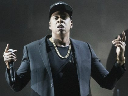 FILE - In this Nov. 4, 2016 file photo, Jay Z performs during a campaign rally for Democratic presidential candidate Hillary Clinton in Cleveland. Jay Z will become the first rapper ever inducted into the Songwriters Hall of Fame when he enters the prestigious organization in June. The Songwriters Hall …