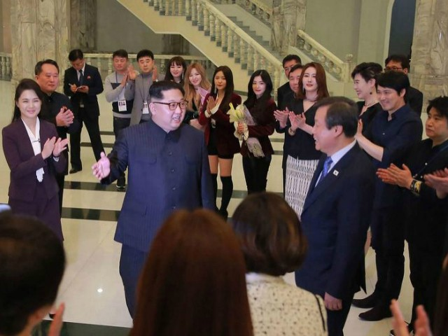 This picture released from North Korea's official Korean Central News Agency (KCNA) on April 2, 2018 and taken on April 1, 2018 shows North Korean leader Kim Jong Un (centre L) speaking to South Korean musicians as his wife Ri Sol-Ju (far L) and South Korea's Culture, Sports and Tourism Minister Do Jong-whan (centre R) look on, after a rare concert by South Korean musicians at the 1,500-seat East Pyongyang Grand Theatre in Pyongyang. Top South Korean musical acts including a K-pop girlband held a rare concert in North Korea on April 1 in the latest reconciliatory gesture before a rare inter-Korean summit. / AFP PHOTO / KCNA VIA KNS / KCNA VIA KNS / South Korea OUT / REPUBLIC OF KOREA OUT ---EDITORS NOTE--- RESTRICTED TO EDITORIAL USE - MANDATORY CREDIT 'AFP PHOTO/KCNA VIA KNS' - NO MARKETING NO ADVERTISING CAMPAIGNS - DISTRIBUTED AS A SERVICE TO CLIENTS THIS PICTURE WAS MADE AVAILABLE BY A THIRD PARTY. AFP CAN NOT INDEPENDENTLY VERIFY THE AUTHENTICITY, LOCATION, DATE AND CONTENT OF THIS IMAGE. THIS PHOTO IS DISTRIBUTED EXACTLY AS RECEIVED BY AFP. / (Photo credit should read KCNA VIA KNS/AFP/Getty Images)