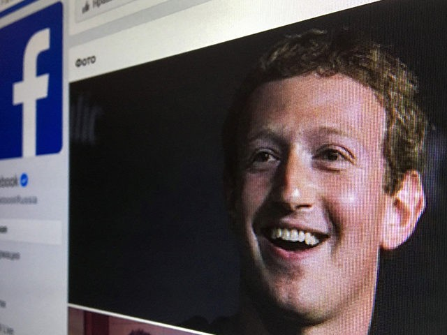 A picture taken in Moscow on March 22, 2018 shows an illustration picture of the Russian language version of Facebook about page featuring the face of founder and CEO Mark Zuckerberg. A public apology by Facebook chief Mark Zuckerberg, on March 22, 2018 failed to quell outrage over the hijacking …