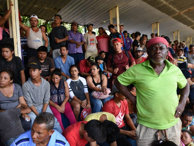 Central Americans -taking part in a caravan called 'Migrant Viacrucis'- rest in Matias Romero, Oaxaca state, Mexico on April 2, 2018. President Donald Trump lashed out in fury Monday over immigration, an outburst triggered by images of a 'caravan' of hundreds of Central American migrants headed towards the US border. …