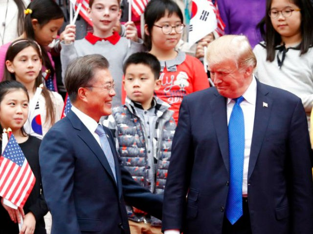 US President Donald Trump (R) and South Korea's President Moon Jae-in attend a welcoming ceremony at the presidential Blue House in Seoul on November 7, 2017. Trump's marathon Asia tour moves to South Korea, another key ally in the struggle with nuclear-armed North Korea, but one with deep reservations about …