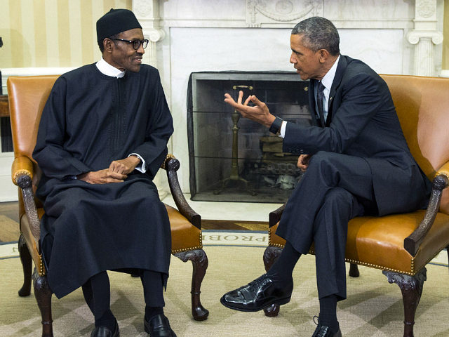 FILE- In this Monday, July 20, 2015 file photo, President Barack Obama, right, meets with Nigerian President Muhammadu Buhari, in the Oval Office of the White House, in Washington. Bomb blasts at two bustling bus stations killed 29 people and wounded 105, officials said Thursday, July 23, 2015, after Nigeria's …