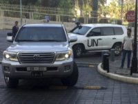 United Nations vehicles carry the team of the Organization for the Prohibition of Chemical Weapons (OPCW), arrive at hotel hours after the U.S., France and Britian launched an attack on Syrian facilities to punish President Bashar Assad for suspected chemical attack against civilians, in Damascus, Syria, Saturday, April 14, 2018. …
