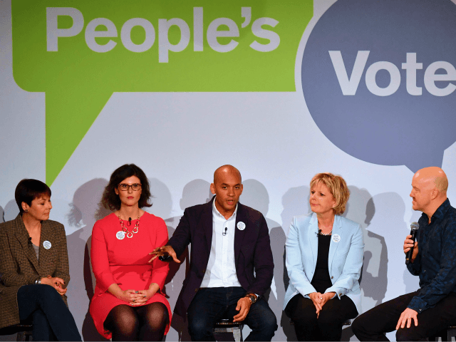 (L-R) British politicians, Green MP Caroline Lucas, Liberal Democrat MP Layla Moran, Labour Party MP Chuka Umunna and Conservative MP Anna Soubry share the stage with comedian Andy Parsons during a launch event for the Peoples Vote campaign in London on April 15, 2018 calling for a referendum on the …