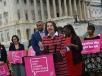 Dawn Laguens, executive vice president of Planned Parenthood Federation of America, spoke at a press conference this week on Capitol Hill about a campaign to maintain its funding stream from taxpayers. Rep. Gwen Moore (D-WI), right, and Rep.March Veasey (D-TX) also spoke at the press conference. (Penny Starr/Breitbart News)