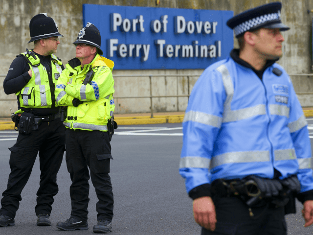 Police officers stand near the Ferry terminal as anti-racism demonstrators block the route of a planned far right march through Dover, southern England, on April 2, 2016. / AFP / JUSTIN TALLIS (Photo credit should read JUSTIN TALLIS/AFP/Getty Images)