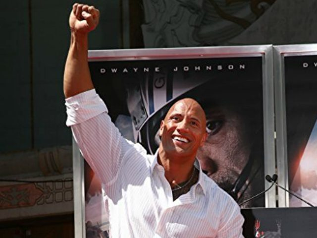 Dwayne 'The Rock' Johnson is immortalized with a hand and footprint ceremony at TCL Chinese Theatre IMAX on May 19, 2015 in Hollywood, California. (Photo by Mark Davis/Getty Images)