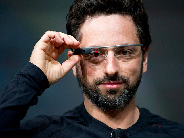 Sergey Brin, co-founder of Google Inc., wears Project Glass internet glasses while speaking at the Google I/O conference in San Francisco, California, U.S., on Wednesday, June 27, 2012. Google Inc. unveiled a $199 handheld computer called the Nexus 7 that features a 7-inch screen and is designed to help the …