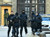 "Police stand outside Stockholm Castle after a truck crashed into the Ahlens department store at Drottninggatan in central Stockholm, April 7, 2017. A truck slammed into a crowd of people outside a busy department store in central Stockholm, causing ""deaths"" in what the prime minister described as a ""terror attack."" …"