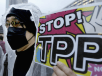 In this April 22, 2104 file photo, a protester holds a placard during a rally against the Trans-Pacific Partnership (TPP) in Tokyo. Donald Trump and Hillary Clinton agree on almost nothing. Except for their dislike of a sweeping agreement that would erase most tariffs and other trade barriers among the U.S. and 11 other nations. All the bashing from the presidential candidates has created more difficulties for the Trans-Pacific Partnership, one of President Barack Obama's top priorities in his final year in office. (AP Photo/Shizuo Kambayashi, File)