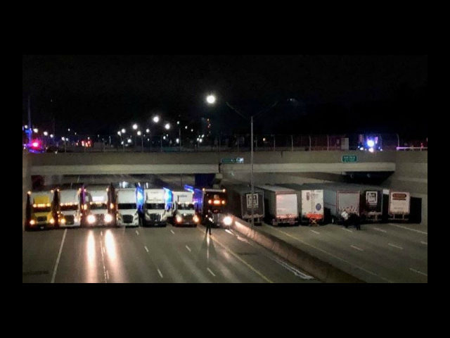 A group of truck-driving good Samaritans answered a call to help save a man threatening to commit suicide by jumping off a freeway overpass on Tuesday.