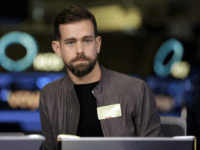 "This photo taken Nov. 19, 2015, shows Square CEO Jack Dorsey being interviewed on the floor of the New York Stock Exchange. Facebook COO Sheryl Sandberg and Twitter CEO Dorsey won't stand for re-election to the board of The Walt Disney Co. A Disney spokesperson says it has become ""increasingly …"