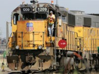 In this Thursday, July 20, 2017, photo, a Union Pacific employee is seen on board a locomotive in a rail yard in Council Bluffs, Iowa. Union Pacific Corp. reports financial results Thursday, Oct. 26, 2017. (AP Photo/Nati Harnik)