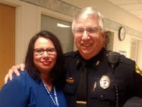 "Nurse Vanessa Guerra and Portage Police Chief Ken Manthey. Guerra earned praise from police after ""body slamming"" a suspect who was attacking the officers as they tried to arrest a man for parole violations, reports say."