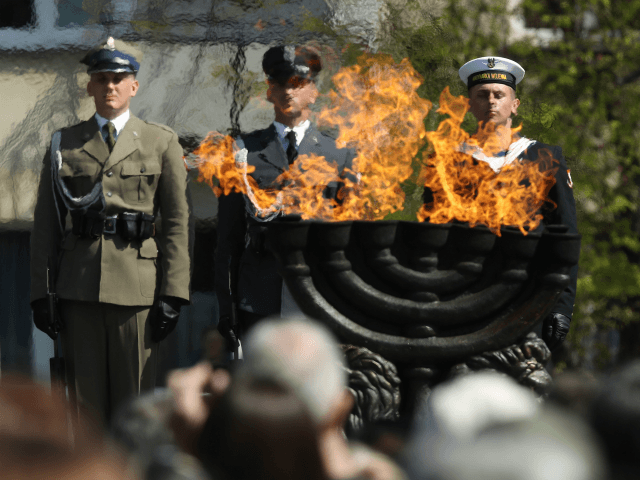 Polish soldiers attend the main commemoration ceremony of the 75th anniversary of the Warsaw Ghetto Uprising on April 19, 2018 in Warsaw, Poland. The Warsaw Ghetto was a prison created by the German military during its occupation of Warsaw during World War II. Starting in 1940, 400,000 Jews were confined …