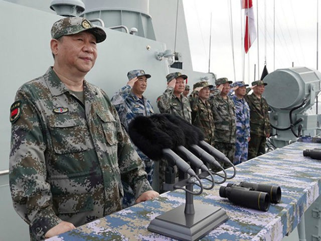 Chinese President Xi Jinping reviews a naval parade Thursday in the South China Sea.