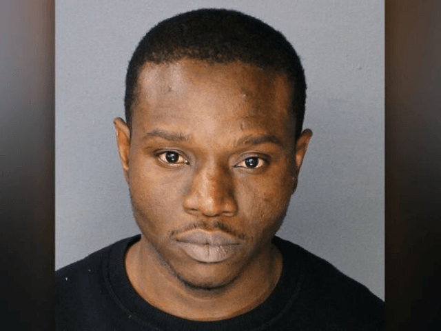 Ainsley Johnson, 34, allegedly bit off a chunk of a cop's finger while in custody at the 69th Precinct in Canarsie, Brooklyn. (NYS Division of Criminal Justice Services)