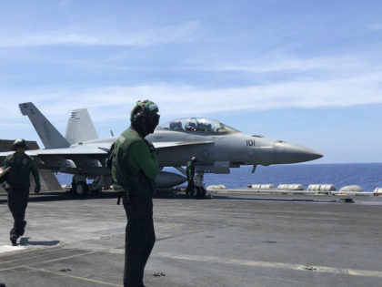Crewmen of the U.S. aircraft carrier Theodore Roosevelt prepare their aircraft Tuesday, April 10,2018 in international waters off South China Sea. The aircraft carrier Theodore Roosevelt (CVN-71) is sailing through the disputed South China Sea in the latest display of America's military might after China built a string of islands …
