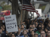 A sign calling for a ban on assault type weapons is held at a vigil for the worst mass shooing in United States history on June 13, 2016 in Los Angeles, United States. A gunman killed 49 people and wounded 53 others at a gay nightclub in Orlando, Florida early yesterday morning before suspect Omar Mateen also died on-scene. (Photo by David McNew/Getty Images)