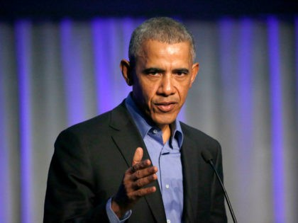 Former President Barack Obama address the participants at a summit on climate change involving mayors from around the globe Tuesday, Dec. 5, 2017, in Chicago. The conference comes after President Trump said the U.S. will pull out of the Paris agreement. (AP Photo/Charles Rex Arbogast)