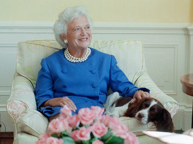 "First lady Barbara Bush, with her pet dog Millie, talks to reporters in Washington, Sept. 11, 1990. Mrs. Bush said Iraq cannot be allowed to get away with its occupation of Kuwait. She also revealed that Millie has a case of lupus but ""she's in complete remission."" (AP Photo/Charles Tasnadi)"