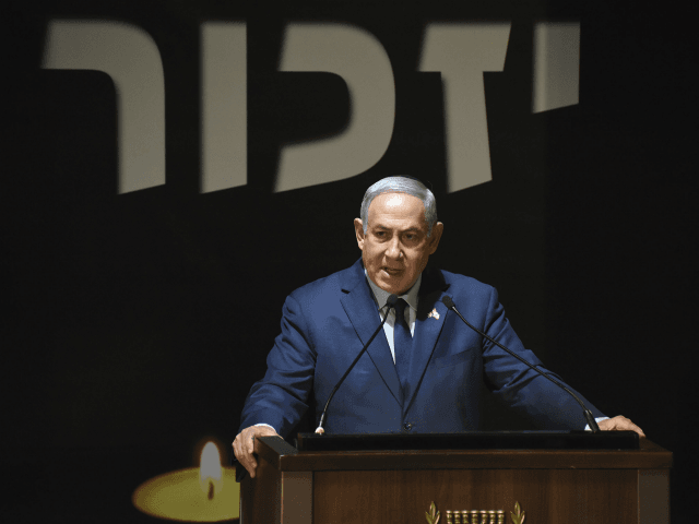 Israeli Prime Minister Benjamin Netanyahu speaks at the official ceremony for Israel's Memorial Day for fallen soldiers, at the National Memorial Hall for Israel's Fallen, in Mt. Herzl Military Cemetery, Jerusalem, Wednesday, April 18, 2018. (Debbie Hill/Pool via AP)