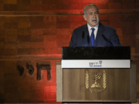 Israeli Prime Minister Benjamin Netanyahu speaks during the Holocaust Remembrance Day ceremony at the Yad Vashem Holocaust memorial in Jerusalem, Wednesday, April 11, 2018. Israel is commemorating its Holocaust Remembrance Day in memory of the 6 million Jews systematically killed by Nazi Germany and its collaborators during World War II. …