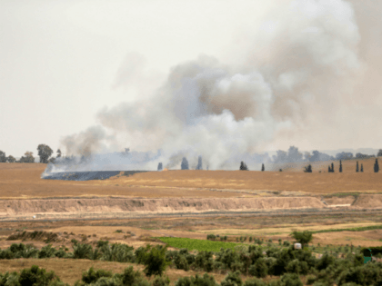 Smoke and flames rise from fields near the Kibbutz Beeri on the Israeli side of the border with the Gaza Strip east of Gaza City, after Palestinians flew a kite laden with a molotov cocktail over the border before cutting the string leaving the burning material to fall in Israeli …