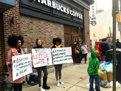 Protesters gather outside a Starbucks in Philadelphia, Sunday, April 15, 2018, where two black men were arrested Thursday after Starbucks employees called police to say the men were trespassing. The arrest prompted accusations of racism on social media. Starbucks CEO Kevin Johnson posted a lengthy statement Saturday night, calling the …