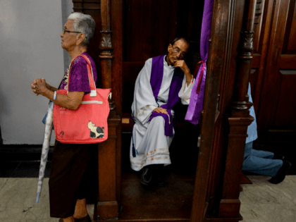 Catholic faithful wait their turn for confession at Santa Teresa basilica in Caracas during the celebration of the Nazarene of Saint Paul, part of the Holy Week festivities, on April 12, 2017. / AFP PHOTO / FEDERICO PARRA (Photo credit should read FEDERICO PARRA/AFP/Getty Images)