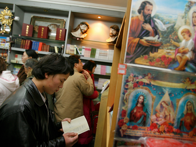Chinese Catholics shop for bibles after midnight Christmas mass at a government approved Catholic church in Beijing, 25 December 2007. China's official Catholic church has installed a new Vatican-approved bishop, the third in a month, state media and a Rome-based religious news agency reported on 22 December as up to …