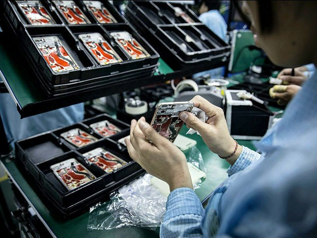 An employee assembles a OnePlus X smartphone at the OnePlus manufacturing facility in Dongguan, China, on Thursday, Dec. 17, 2015. OnePlus is part of a crop of upstart Chinese companies that are intensifying competition throughout the industry and crushing profit at established giants such HTC Corp. and Samsung Electronics Co. …