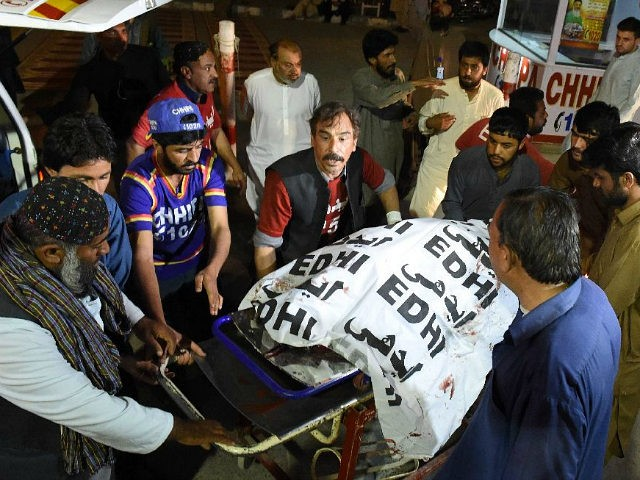 Pakistani volunteers move the body of a Christian resident killed in an attack by gunmen to a hospital in Quetta on April 2, 2018. Four Christians were killed and a child injured in what officials say was a targeted attack against the religious minority group in Pakistan's southwestern city of …