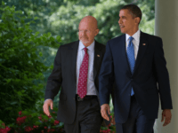 S President Barack Obama walks back down the West Wing Colonnade alongside retired General James Clapper, Obama's nominee for director of national intelligence, before making a statement in the Rose Garden of the White House in Washington, DC, June 5, 2010. AFP PHOTO / Saul LOEB (Photo credit should read SAUL LOEB/AFP/Getty Images)