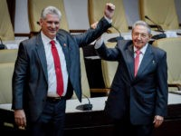 HAVANA, CUBA - APRIL 19: Former Cuban President Raul Castro raises the arm of newly elected Cuban President Miguel Diaz-Canel during the National Assembly at Convention Palace on April 19, 2018 in Havana, Cuba Diaz-Canel will be the first non-Castro Cuban president since 1976. Raul Castro steps down after 12 …