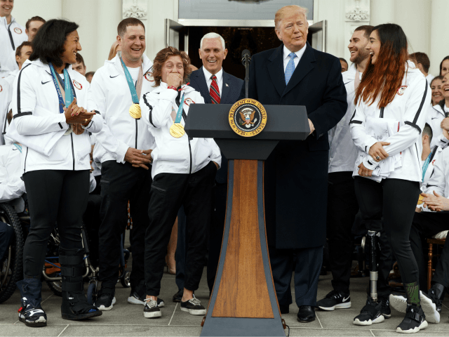 President Donald Trump jokes with Olympic snowboarding gold medalist Redmond Gerard during an event with the United States Olympic and Paralympic Teams at the White House, Friday, April 27, 2018, in Washington. (AP Photo/Evan Vucci)