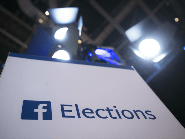 In this Aug. 6, 2015, file photo Facebook Elections signs stand in the media area in Cleveland before the first Republican presidential debate. The head of Trump-affiliated data-mining firm Cambridge Analytica was suspended on Tuesday, March 20, 2018, while government authorities are bearing down on both the firm and Facebook …