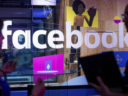 FILE - In this April 18, 2017, file photo, conference workers speak in front of a demo booth at Facebook's annual F8 developer conference, in San Jose, Calif. One of the congressional committees investigating Russia's interference in the 2016 election has invited the tech giants Facebook, Twitter and the parent …