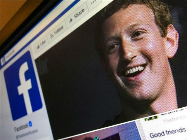 A picture taken in Moscow on March 22, 2018 shows an illustration picture of the English language version of Facebook about page featuring the face of founder and CEO Mark Zuckerberg. A public apology by Facebook chief Mark Zuckerberg, on March 22, 2018 failed to quell outrage over the hijacking …