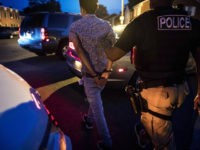 MANASSAS, VA - Northern Virginia Gang Task Force officers partner with ICE officer to arrest an alleged MS-13 gang member in a Manassas, Virginia neighborhood Thursday evening August 10, 2017. (Photo by Melina Mara/The Washington Post via Getty Images)