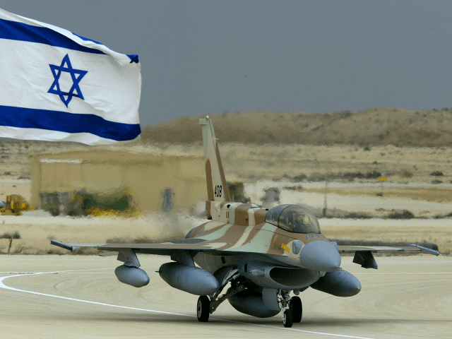 RAMON AIR FORCE BASE, ISRAEL - FEBRUARY 19: Israel's first F-16i jet fighter, called in Hebrew Sufa (Storm), taxis after landing February 19, 2004 at the Ramon Air Force Base in Israel's Negev desert. The air force took delivery of the first two of 102 of the long-range advanced American-made …