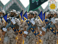 Iranian soldiers march during the annual military parade marking the anniversary of the outbreak of its devastating 1980-1988 war with Saddam Hussein's Iraq, on September 22,2017 in Tehran. President Hassan Rouhani vowed that Iran would boost its ballistic missile capabilities despite criticism from the United States and also France. / …