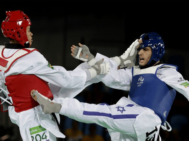 Ron Atias of Israel, and Venilton Teixeira of Brazil compete in the men's Taekwondo event at the 2016 Summer Olympics in Rio de Janeiro, Brazil, Wednesday, Aug. 17, 2016. (AP Photo/Andrew Medichini)