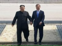 In this image taken from video provided by Korea Broadcasting System Friday, April 27, 2018, North Korean leader Kim Jong Un, left, crosses the border into South Korea, along with South Korean President Moon Jae-in for their historic face-to-face talks, in Panmunjom. Their discussions will be expected to focus on …